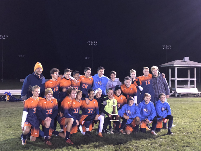 JV soccer bringing home a trophy from Peoria.
