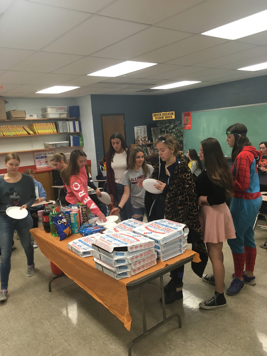 Pizza Party reward for winning spirit week competition.