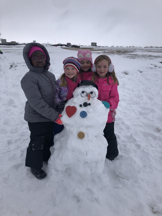 A snowman with a huge heart for 1st graders.