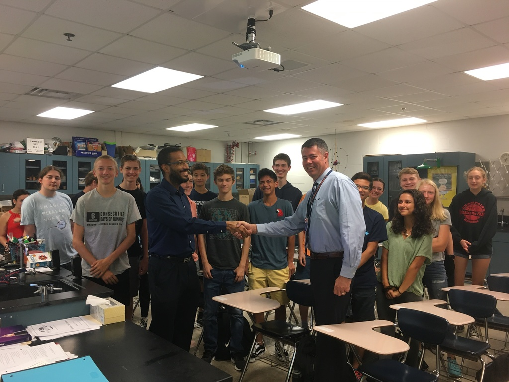Dr. Lynford Goddard, principal Chad Benedict, and the MSHS STEM club