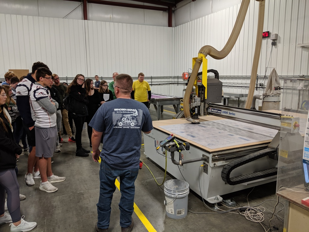 Bendsen manufacturing manager showing the students their industrial CNC machine